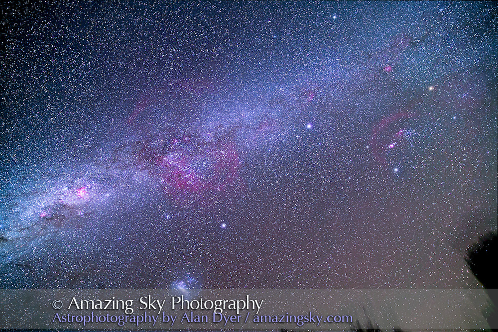 An ultrawide-angle view of the Milky Way seen from the southern hemisphere, from Australia, March 21, 2014. This takes the far southern Milky Way, from Orion at far right, to Canis Major, Puppis, Vela, and to Carina at far left. Sirius and Canopus are upper right and lower left of centre. The Large Magellanic Cloud is at lower left. The vast Gum Nebula complex is at centre. <br /> <br /> This is a stack of 8 x 4 minute exposures at f/2.8 with the Rokinon 14mm lens and Canon 5D MkII at ISO 800 I shot this March 21, 2014 from the Warrumbungles Motel, Coonabarabra, NSW, Australia.