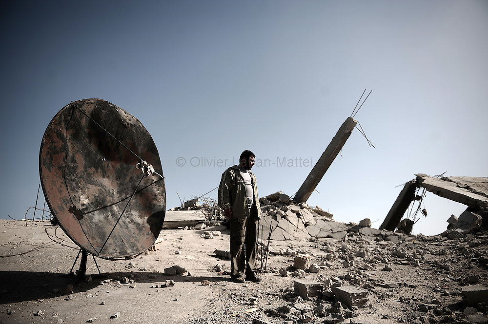 Palestinian Khaled Abedrabbo walks on the rubble of his house in Jabalia's Ezbet Abed Rabbo neighbourhood on January 25, 2009. Israeli soldiers killed his two daughters in front of his eyes before destroying his house.