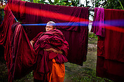 A novice monk tends to the laundry at a monastery in Yangon, Myanmar.