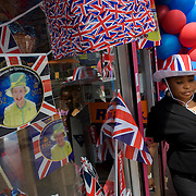 Mother and child with patriotic bunting, flags, balloons and royal memorabilia on display before the Queen's Golden Jubilee in a south London shop window.