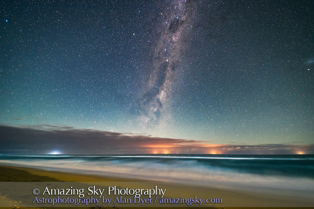 The Dark Emu of aboriginal sky lore rising in a moonlit sky over the Tasman Sea from a beach near Lakes Entrance, Victoria, Australia, April 2, 2017. Lights from fishing boats dot the horizon out at sea. Illumination is from the waxing crescent Moon behind the camera to the north. This is looking southeast. Crux, the Southern Cross, is at top; the Pointer Stars are below. <br /> <br /> This is a single exposure, from a 300-frame time-lapse, at 36 seconds at ISO 3200 and f/2.5 with the Rokinon 14mm lens and Canon 6D.