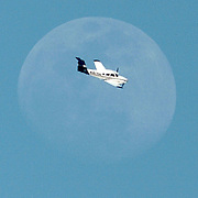 Joe Imel/Daily News     MOON FLIGHT   A twin-engined plane makes a turn in fron of the moon MOnday to land at the Bowling Green-Warren County Regional AIrport. Clear skies and warmer weather are anticipated this week in Southcentral Kentucky.