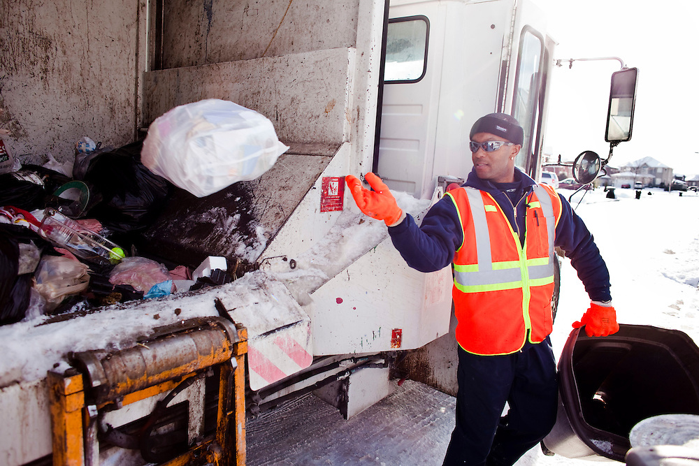 Windsor, Ontario ---10-12-16--- Richard Calvert of Turtle Island Recycling picks up garbage in Windsor, Ontario, December 16, 2010. The private company has recently taken over responsibility for garbage pickup from city workers.<br /> GEOFF ROBINS The Globe and Mail