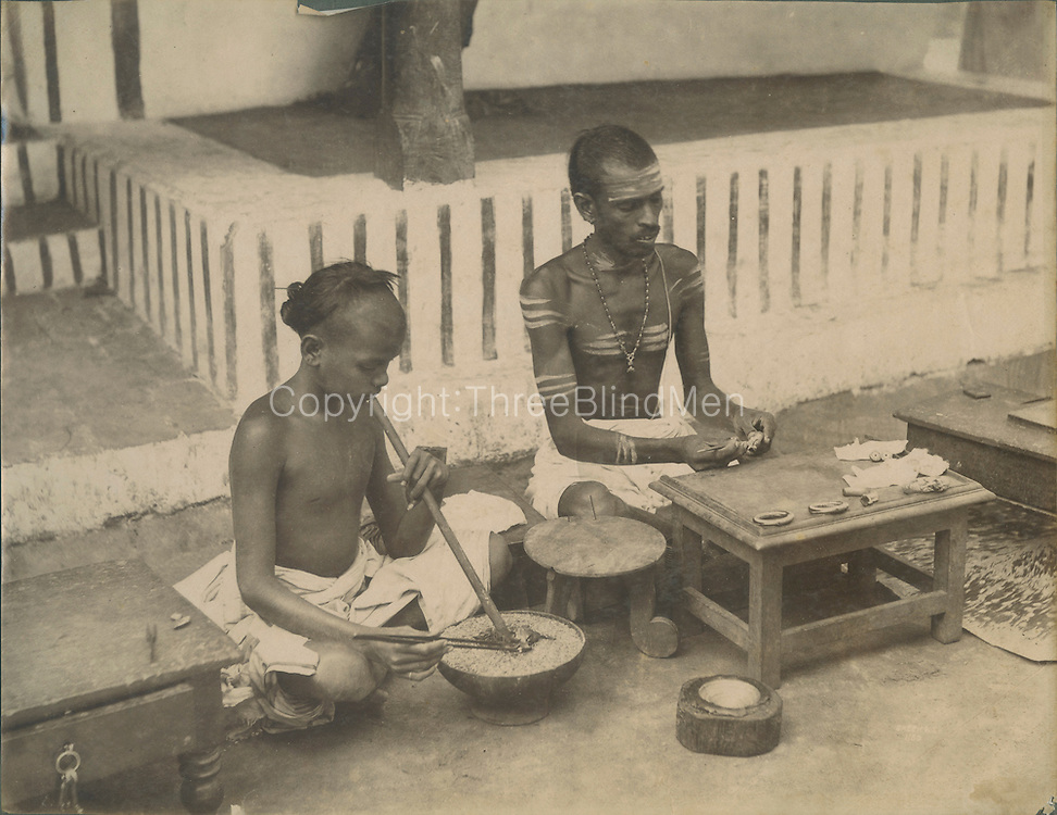 Jewelers at work..Archival Black and white photograph.