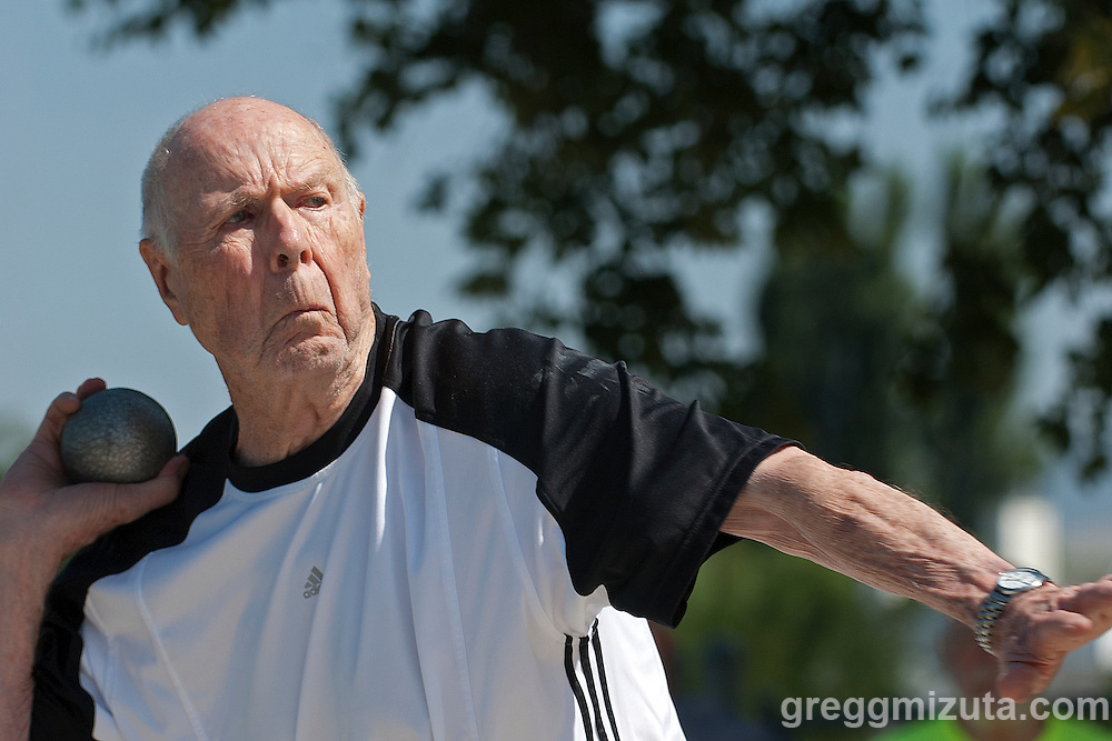 Herbert Wilkinson throws the shot during the Idaho Senior Games at Timberline High School in Boise, Idaho on August 3, 2013. Wilkinson finished first in the M90 Division with a throw of 26-00.00.