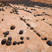 Moqui Balls collect on the surface of sandstone slickrock in Southern Utah.
