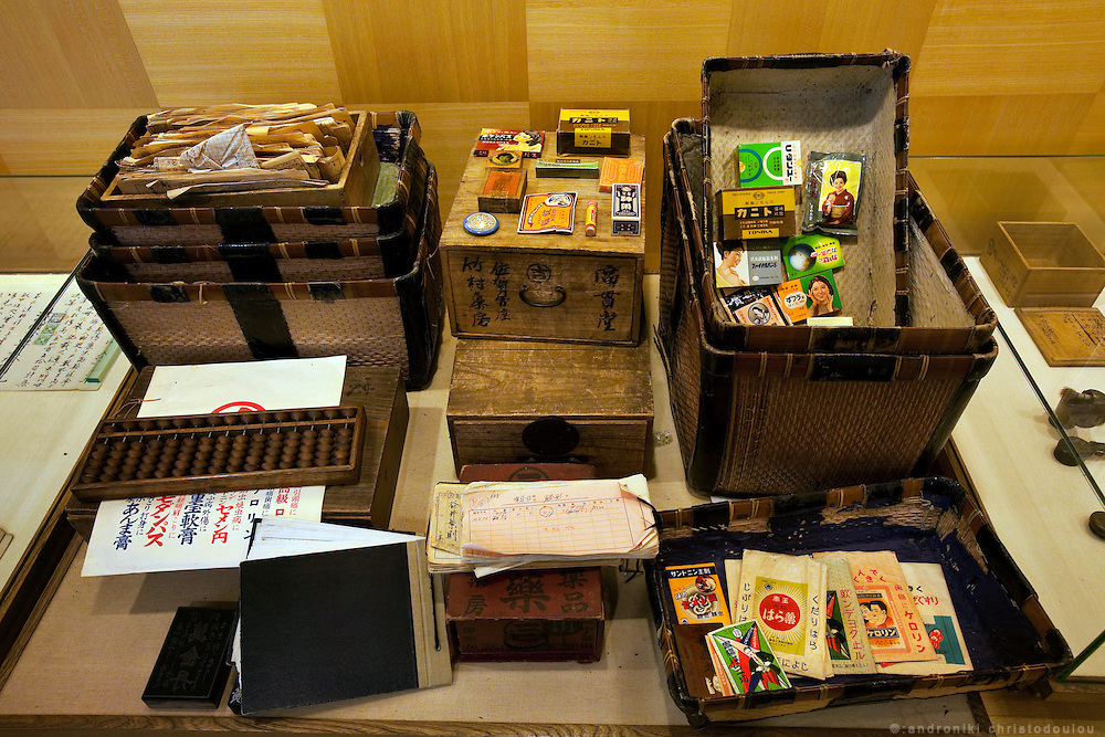 """TOYAMA MEDICINETraditional medicne-boxes and their incredients at the museum of Kokando traditional medicine company, one of the oldest medicine in Toyama, city founded in 1876. Medicines manufactured in Toyama spread by medicine peddlers who were called """"Baiyaku-san"""". They traveled all over Japan bringing medicine boxes to their clients, employing a unique business style known as """"Senyo-kori"""" (Use first, and pay later service), in which a box filled with medicines is placed at customer's home free of charge, and later the customer pays for actual consumption. Today, a lot of Baiyaku-san are still active in Japan.Toyama prefecture is located near the center of Japan and is approximately the same distance from the three largest cities in Japan-Tokyo, Nagoya and Osaka. Toyama's pharmaceutical tradition has a more than 300 years history. As it is located on the Japan sea, it is facing China and has been an importer of traditional Chinese medicine knowledge which it developed through the years. There are now approximately 100 manufactures and over 100 factories in Toyama in terms of pharmaceutical products and Toyama prefecture acquires a steady reputation as Japan's medicine manufacturing base."""