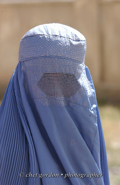 """An Afghan woman dressed in the traditional burka waits to enter the Charasyab health clinic approximately 20 kilometers outside of Kabul, Afghanistan on Sunday, May 26, 2002. A humanitarian mission organized by The Geshundheit Instititute, founded by Dr. Hunter """"Patch"""" Adams, Lufthansa Cargo, and DHL Worldwide Express collaborated to ship medicines, food and orthopedic supplies to the Indira Ghandi Children's Hospital, clinics and orphanages in Kabul. The German NGO (Non Governmental Organization) Hammer Forum supervised the distribution of the donated supplies from various non-profit organizations in the U.S. and The Netherlands."""