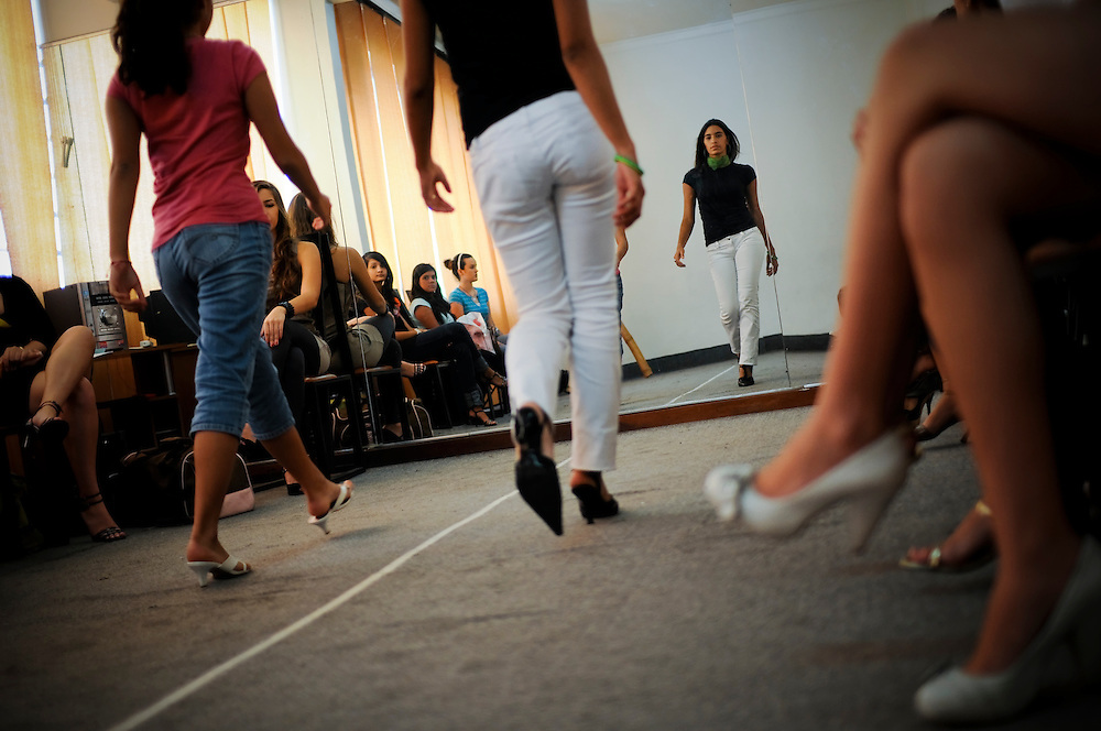 """Students attend """"Catwalk, Elegance, Protocol and Etiquette"""" class at Gisselle's International Models school in Caracas, Venezuela..The majority of girls that attend the school dream of becoming future Miss Venezuelas or models..The school is highly acclaimed and run by former Miss Venezuela, Gisselle Reyes."""