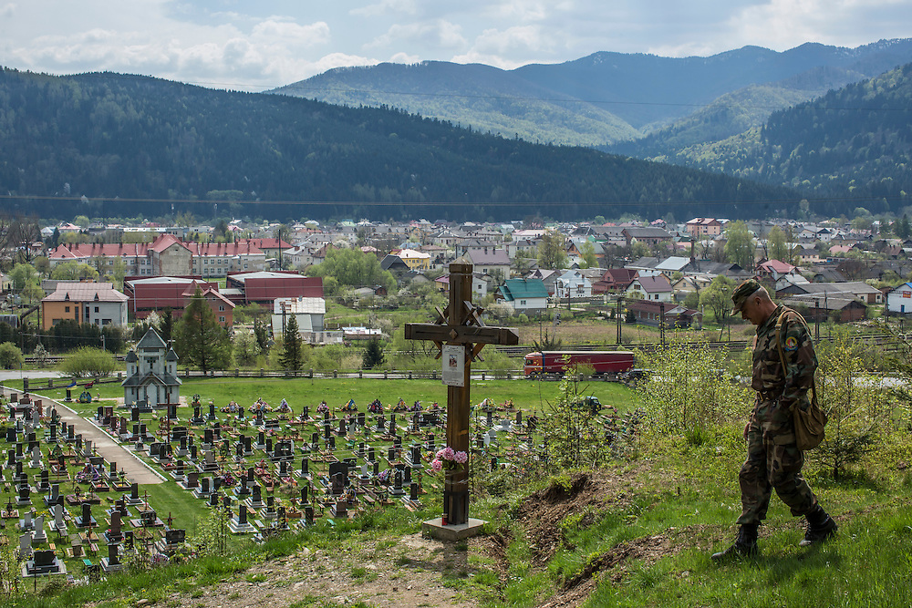 SKOLE, UKRAINE - MAY 1, 2015: Volodymyr Kharchuk, deputy director of the organization Dolya, walks down from the site of mass graves believed to contain the remains of Ukrainian partisans above the town of Skole, Ukraine. Dolya was formed to excavate and repatriate remains from World War II, though its focus is often on locating the graves of Ukrainian partisans killed by Soviet forces. CREDIT: Brendan Hoffman for The New York Times