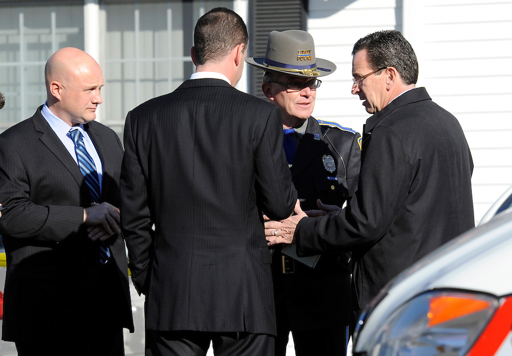 Gov. Dannel P. Malloy, right, talks with officials at a staging area following a shooting at the Sandy Hook Elementary School in Newtown, Conn. where authorities say a gunman opened fire, leaving 26 people dead, including 20 children, Friday, Dec. 14, 2012. (AP Photo/Jessica Hill)