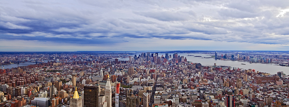 New York, New York City skyline from Empire State Building, with the Hudson River in the background.