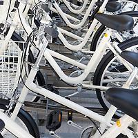 12 Muji bicycles that residents of the 'Muji Village' apartment block building can use, in Tsudanuma, Tokyo, Japan. Monday 26th April 2010.