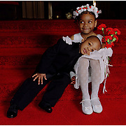 The flower girl offers a lap to the ring bearer as they patiently wait for all the group shots to finish up.