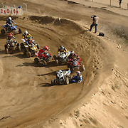 The third picture of the sequence of a crash at the ATVA MX National Feb 4-5, 2006 at Glen Helen. The third picture shows (#4) Tim Farr and(#55) Doug Gust colliding, which actually straightens Farr out.  Jones (#2) falls to the ground in front of Joe Byrd (#7).  Dana Creech (#52) gets het from behind by Dustin Nelson (#94) as Jeremy Lawson (#16) narrowly misses them both.