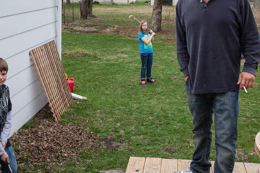 Steve McFarland plays with his kids in his back yard on Wednesday, March 21, 2012 in Webster City, IA.