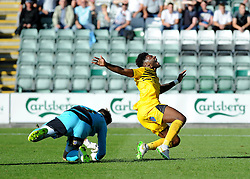 Luke McCormick of Plymouth Argyle brings down Ellis Harrison of Bristol Rovers for a penalty - Mandatory byline: Neil Brookman/JMP - 07966 386802 - 19/09/2015 - FOOTBALL - Home Park - Plymouth, England - Plymouth Argyle v Bristol Rovers - Sky Bet League Two