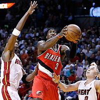 08 March 2011: Portland Trail Blazers small forward Gerald Wallace (3) goes to the basket past Miami Heat power forward Chris Bosh (1) and Miami Heat point guard Mike Bibby (0) during the Portland Trail Blazers 105-96 victory over the Miami Heat at the AmericanAirlines Arena, Miami, Florida, USA.