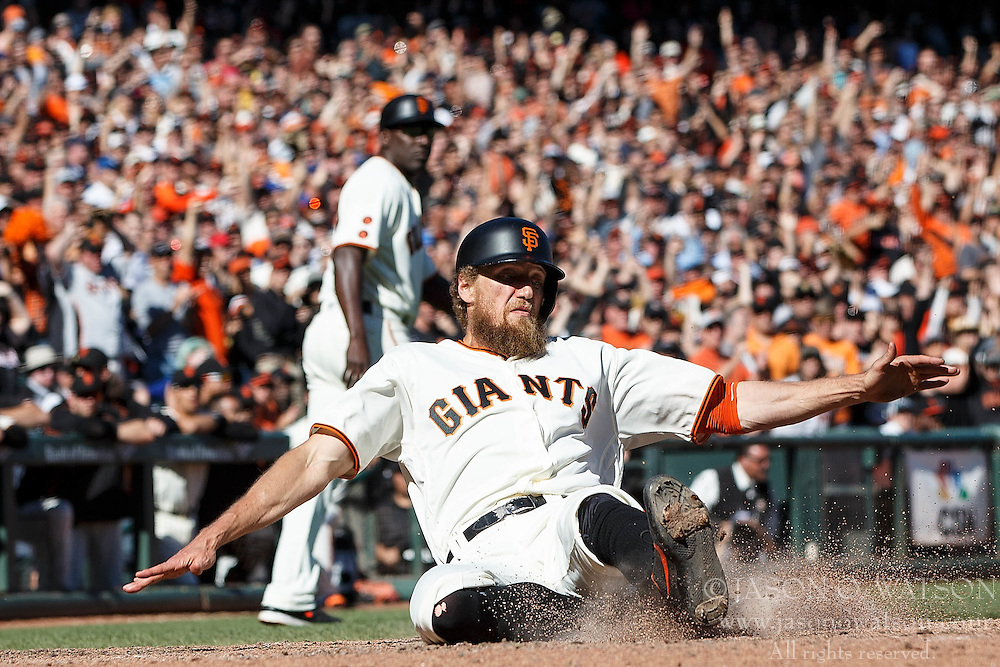 SAN FRANCISCO, CA - OCTOBER 02: Hunter Pence #8 of the San Francisco Giants slides into home plate to score a run against the Los Angeles Dodgers during the eighth inning at AT&T Park on October 2, 2016 in San Francisco, California. The San Francisco Giants defeated the Los Angeles Dodgers 7-1. (Photo by Jason O. Watson/Getty Images) *** Local Caption *** Hunter Pence