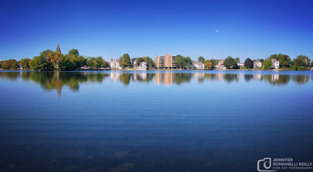 Moon and reflections of downtown Oconomowoc in Fowler Lake.