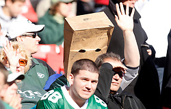 Nov 29, 2009; East Rutherford, NJ, USA; A New York Jets fan hides his face during the first half at Giants Stadium.