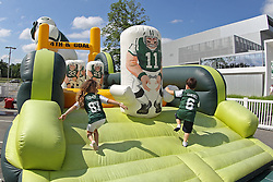 June 14, 2012; Florham Park, NJ, USA; Young New York Jets fans play games before New York Jets Minicamp at the Atlantic Health Training Center.