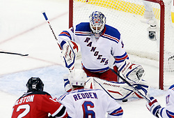 Oct 5, 2009; Newark, NJ, USA; New York Rangers goalie Henrik Lundqvist (30) makes a pad save during the second period at the Prudential Center.