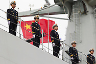 Officers stand to attention aboard the Chinese Naval assault ship Chang Bai Shan at Portsmouth Royal Navy Base today. The ship is involved in the first visit by the Chinese Navy to the UK since 2007 and the largest ever. She is accompanied by the frigate Yun Cheng and the replenishment ship Chaohu. The ships arrived in Portsmouth 24 hours early due to the expected bad weather. The Royal Navy statement stated that the five day formal visit is aimed at enhancing military understanding between the UK and China. Picture date Monday 12th January, 2015.<br /> Picture by Christopher Ison. Contact +447544 044177 chris@christopherison.com
