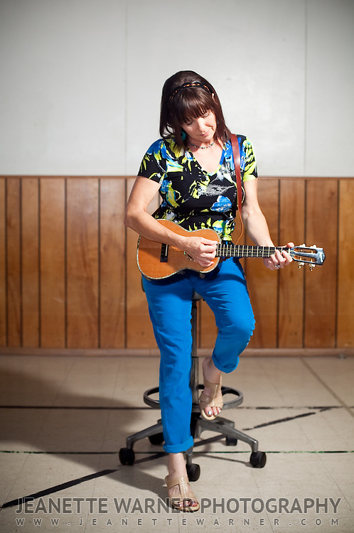 People pose with their ukulele for a portrait session in Austin, Texas.