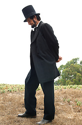 Abraham Lincoln standing outside at Gettysburg