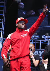 """LAS VEGAS, NV - MAY 2: Floyd """"Money"""" Mayweather Jr. waves to fans at the weigh in for his WBA/WBC welterweight championship fight against Marcos Maidana at the MGM Grand Garden Arena on May 2, 2014 in Las Vegas, Nevada. (Photo by Ed Mulholland/Golden Boy/Golden Boy via Getty Images) *** Local Caption ***Floyd Mayweather;"""