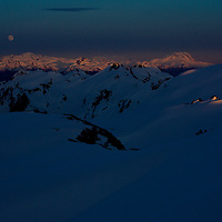 Very late in the season I went snowmobiling up Brandywine to try to get some good evening snowboarding photos. After we got the shots we wanted the moon started to come up over Whistler just as the sun was setting behind us.