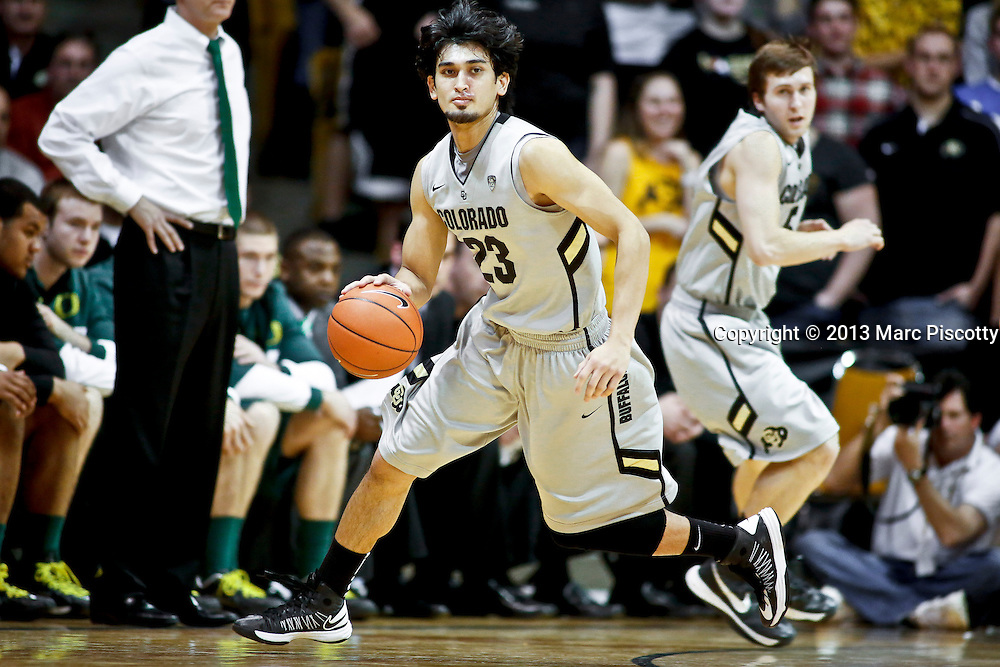 SHOT 3/7/13 7:48:45 PM - Colorado's Sabatino Chen #23 dribbles the ball against Oregon during their Pac-12 Conference regular season basketball game at the Coors Events Center on the University of Colorado campus in Boulder, Co. Colorado won the game 76-53..(Photo by Marc Piscotty / © 2013)