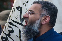 London, 22 November 2013. Radical Islamist preacher Anjem Choudary speaks as his Islam4UK hold a protest and leafleting outreach to the public in Chinatown to highlight the persecution of Muslims in China.