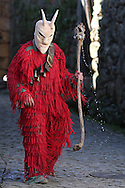 """A Reveller with wooden mask and carnival garb during the traditional Celtic carnival """"Caretos"""" in the village of Lazarim, central Portugal on February 17, 2015. PAULO CUNHA /4SEE"""