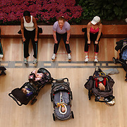 (left to right) Mothers and their children work out with a stroller fitness class at the Westfield Fox Valley Mall in Aurora, Illinois..
