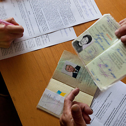 Attorneys and paralegals hold a Òspecial consultationÓ for potential clients who are children of the Second World War, Rivne, Ukraine, June 15, 2011. This vulnerable group is made up of seniors, most of whom are not receiving proper compensation as promised by the government. The legal team advises them on how to properly fill out forms and submit them to the courthouse, while encouraging them not to give up on their rights. More than half of the worldÕs population, four billion people, live outside the rule of law, with no effective title to property, access to courts or redress for official abuse. The Open Society Justice Initiative is involved in building capacity and developing pilot programs through the use of community-based advocates and paralegals in Sierra Leone, Ukraine and Indonesia. The pilot programs, which combine education with grassroots tools to provide concrete solutions to instances of injustice, help give poor people some measure of control over their lives.