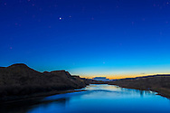 Venus (bright at top) and Mercury (faint and low in the twilight) with both planets about as high as they will get this spring at my latitude of 51&deg; N in Alberta. Mercury&rsquo;s date of greatest elongation is May 6. <br /> <br /> I shot this May 2, 2015 from the bridge over the Red Deer River near Dorothy, Alberta. Light from the nearly Full Moon rising in the east behind me provides some of the landscape illumination.<br /> <br /> This is a high dynamic range stack of 5 exposures at 1-stop intervals, using the Canon 6D and 35mm lens.