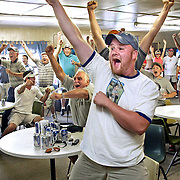 Jeremy Fisher of Oquawka, Ill. celebrates with fans as golfer Todd Hamilton sinks his final putt on the 18th hole to win the British Open Sunday, July 18, 2004, at Hamilton's home course, Hend-Co Hills Golf Club in Biggsville, Ill. About 40 people watched at the club house as Hamilton won his first major tournament.