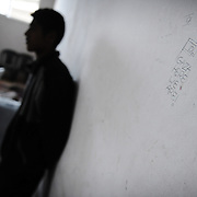 "A Palestinian youth leans on a wall bearing a sketch of an Israeli flag and reading ""Gaza here we are"", allegedly left behind by Israeli soldiers, at a house in the Zeitun district of Gaza City on January 23, 2009. A Hamas delegation from Gaza crossed into Egypt for talks to shore up the ceasefire with Israel which ended a 22-day assault on the coastal strip, a border official said. Israel and Hamas have observed their own ceasefires since January 18 when Israel ended Operation Cast Lead leaving a trail of devastation and 1,330 Palestinians dead, according to doctors. Egypt is trying to secure a durable ceasefire between Israel and Hamas and the reopening of crossings."