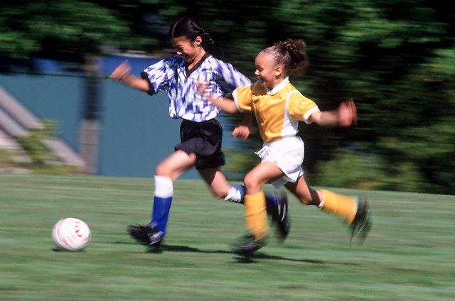 Girls Playing Soccer --- Image by © Jim Cummins/CORBIS
