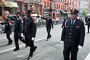 September 16, 2012- Harlem, New York: FDNY EMTs at the 42nd Annual African American Day Parade held along Adam Clayton Blvd on September 16, 2012 in Harlem New York City. The first African American Day Parade was held in September 1969 in Harlem. The first Grand Marshal was Congressman Adam Clayton Powell, Jr. The purpose of the parade is to provide an opportunity for African people to join together on a Special Day to highlight history and salute African people throughout America and the world for their outstanding achievements.  (Terrence Jennings)
