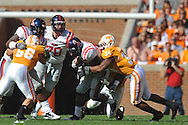 Ole Miss running back Enrique Davis (27) is tackled by Tennessee linebacker Herman Lathers (34) in a college football game at Neyland Stadium in Knoxville, Tenn. on Saturday, November 13, 2010. Tennessee won 52-14.