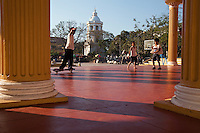 Skateboarders at Plaza Burgos  - with a childrens park and food court that sells local foods Plaza Burgos is favorite spot for locals to hang out.