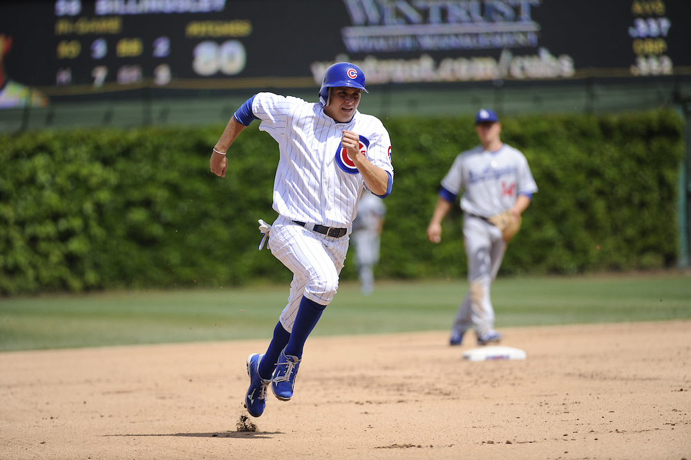 CHICAGO - MAY  04:  Tony Campana #1 of the Chicago Cubs runs the bases against the Los Angeles Dodgers on May 4, 2012 at Wrigley Field in Chicago, Illinois.  The Cubs defeated the Dodgers 5-4.  (Photo by Ron Vesely)   Subject:  Tony Campana