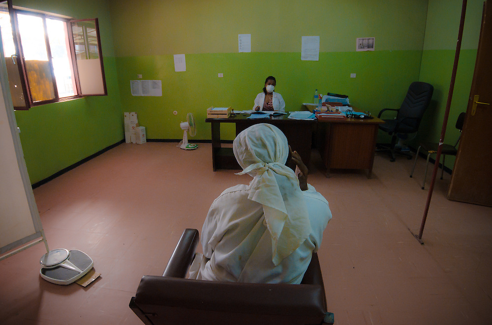 A patient and doctor sit 15 feet apart during a routine TB consultation. Addis Ababa, Ethiopia.