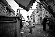 """Garbage collecter Khachik (c.) at work with his colleagues. This image is part of the photoproject """"The Twentieth Spring"""", a portrait of caucasian town Shushi 20 years after its so called """"Liberation"""" by armenian fighters. In its more than two centuries old history Shushi was ruled by different powers like armeniens, persians, russian or aseris. In 1991 a fierce battle for Karabakhs independence from Azerbaijan began. During the breakdown of Sowjet Union armenians didn´t want to stay within the Republic of Azerbaijan anymore. 1992 armenians manage to takeover """"ancient armenian Shushi"""" and pushed out remained aseris forces which had operate a rocket base there. Since then Shushi became an """"armenian town"""" again. Today, 20 yeras after statement of Karabakhs independence Shushi tries to find it´s opportunities for it´s future. The less populated town is still affected by devastation and ruins by it´s violent history. Life is mostly a daily struggle for the inhabitants to get expenses covered, caused by a lack of jobs and almost no perspective for a sustainable economic development. Shushi depends on donations by diaspora armenians. On the other hand those donations have made it possible to rebuild a cultural centre, recover new asphalt roads and other infrastructure. 20 years after Shushis fall into armenian hands Babies get born and people won´t never be under aseris rule again. The bloody early 1990´s civil war has moved into the trenches of the frontline 20 kilometer away from Shushi where it stuck since 1994. The karabakh conflict is still not solved and could turn to an open war every day. Nonetheless life goes on on the south caucasian rocky tip above mountainious region of Karabakh where Shushi enthrones ever since centuries."""