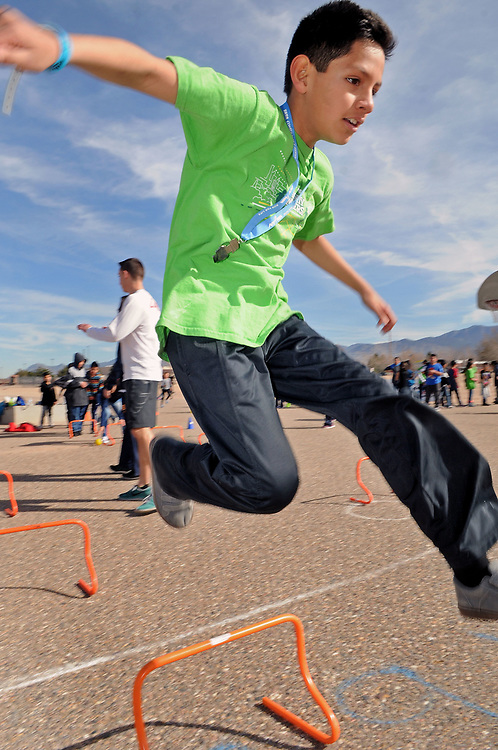 jt030317a/a sec/jim thompson/ Juan Bazan, 5th grader at Wherry Elementary School in one of the jumping stations at the USATF RunJumpThrow experience Friday morning in Albuquerque, NM.  Friday March 03, 2017. (Jim Thompson/Albuquerque Journal)