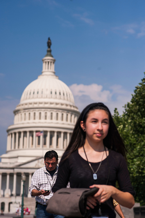 Photo by Matt Roth<br /> <br /> Ohio constituents Mario Vargas, a farmworker organizer from Ohio, and his daughter Myra Vargas, walk past the U.S. Capitol to meet with John Crown, Legislative Assistant in Senator Sherrod Brown's office in the Hart Senate Office Building during the Farmworker Fly In event in Washington, D.C. on Tuesday, July 16, 2013.