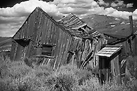House in Decay at Bodie State Park in California. Image taken with a Nikon D3s and 50 mm f/1.4G lens (ISO 200, 50 mm, f/2.8, 1/2000 sec). Raw image processed with Capture One 6 (including conversion to B&W)